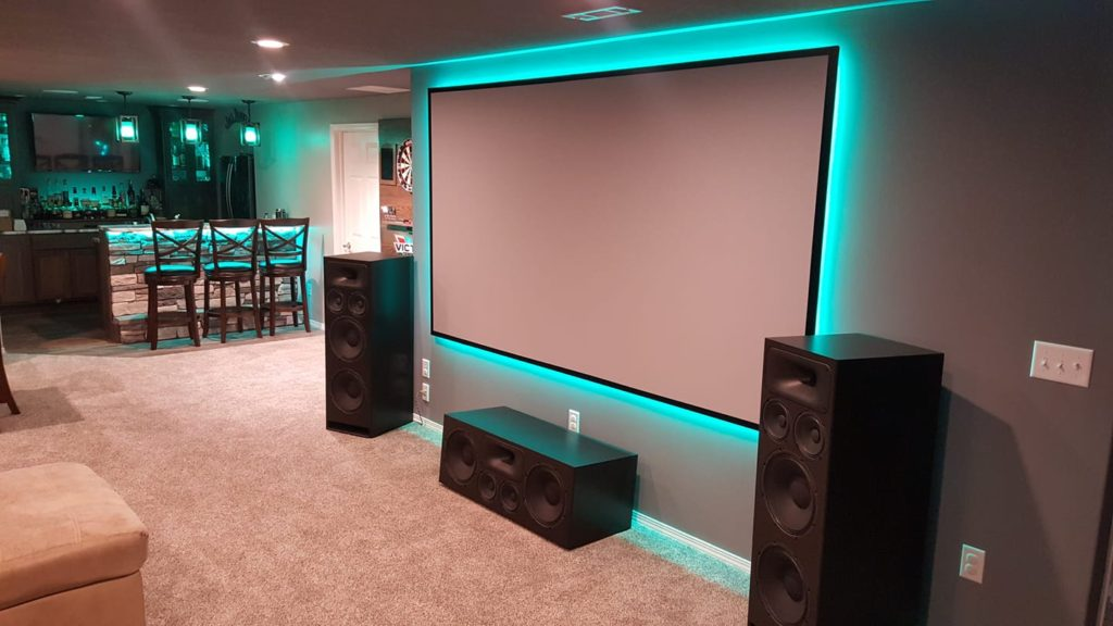 Home theater setup with DIY back lit projector screen